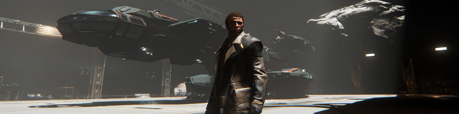 A man standing in front of a landed space cutter.